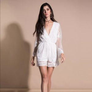 Pants - Brand new white romper with lace